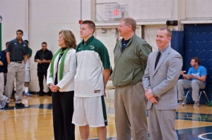 Zack Zeltman poses with his parents, Marcia Zeltman and Mark Zeltman, along with coach Matt Moore at the honor ceremony before the game against Spring Arbor University. Photo courtesy of Jon King