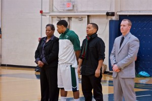 Jason Dawson along with his parents and coach Matt Moore wait at the honor ceremony before the game against Spring Arbor University. Photo courtesy of Jon King